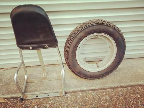 Vespa motorcycle passenger backrest and spare wheel/tyre